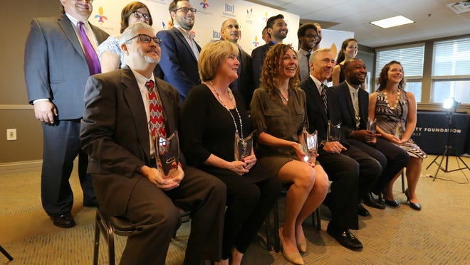 Winners of the Vogt Awards pose for a photograph at the Community Foundation of Louisville on Wednesday morning. August 24, 2016