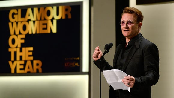 Bono accepts the Man of the Year award onstage at NeueHouse
