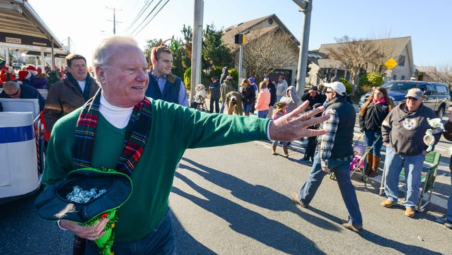 In this Daily Times file photo, Ocean City Mayor Rick Meehan throws candy to the crowds lined up along Coastal Highway during the 2015 Christmas parade.