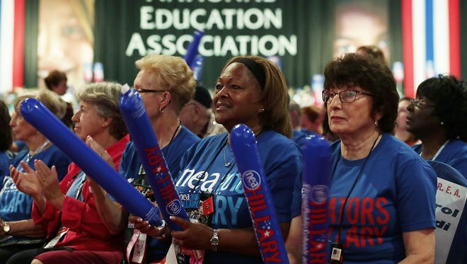 Delegates to the Representative Assembly of the National Education Association wait for Democratic presidential candidate Hillary Rodham Clinton to speak, July 5, 2016 in Washington, D.C.