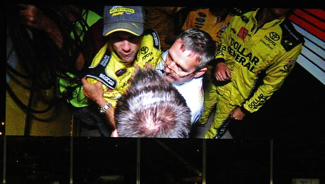 NASCAR Sprint Cup Series driver Matt Kenseth is involved in fisticuffs between haulers following the the Bank of America 500 in an image shown on the video display board at Charlotte Motor Speedway in Concord, N.C., on Saturday, Oct. 11, 2014. (Jeff Siner/Charlotte Observer/MCT)