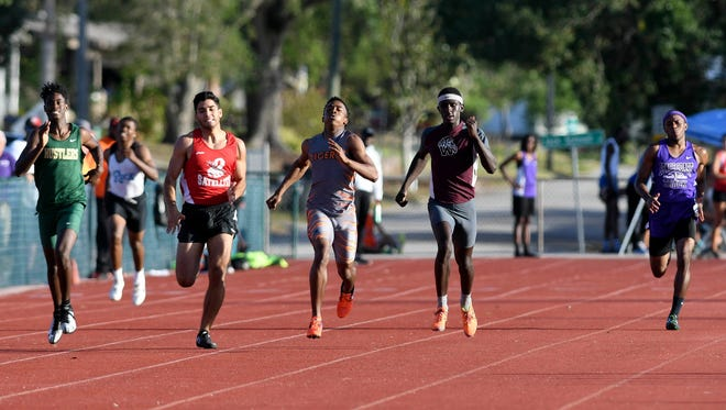 Boys run the 400 during the District 13-2A track and field meet Thursday in Titusville.
