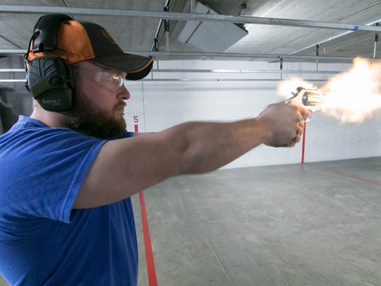 Employee Brad McClements fires a .357 Smith and Wesson 686 in the gun range at Peacemakers Gun Range in Howell May 2, 2018.