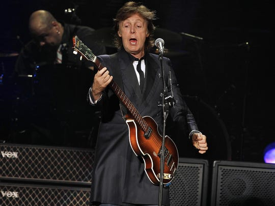 Paul McCartney performs at Miller Park in Milwaukee, Wisconsin, July 16, 2013 as part of his Out There tour.