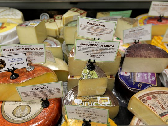 A variety of cheeses are sold at Sickles Market.
