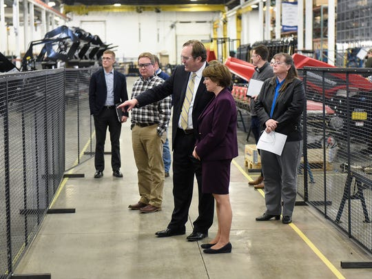 Geringhoff President and CEO Tosh Brinkerhoff explains a process in the St. Cloud facility to U.S. Sen. Amy Klobuchar during a Thursday, April 5, tour.