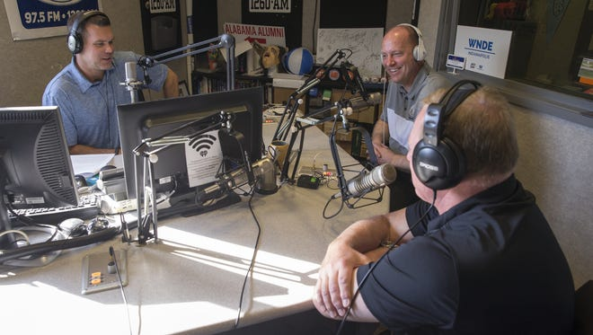 Jake Query, left, of Query and Schultz on Fox Sports 97.5, interviews Purdue's football coach Jeff Brohm, back, and Athletic Director Mike Bobinski. They spent a day pitching the story of Purdue sports on television and radio stations.
