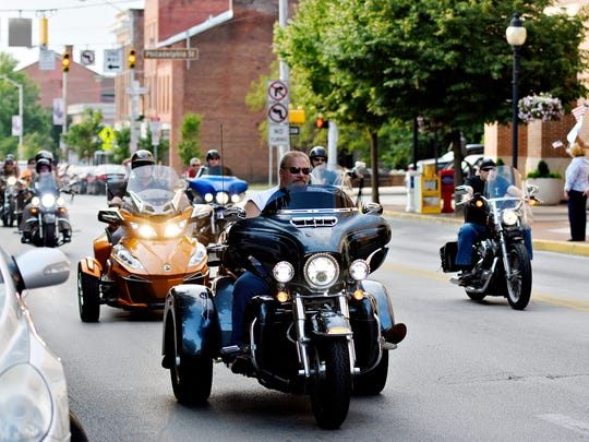 Motorcycle riders pass the York County Judicial Center