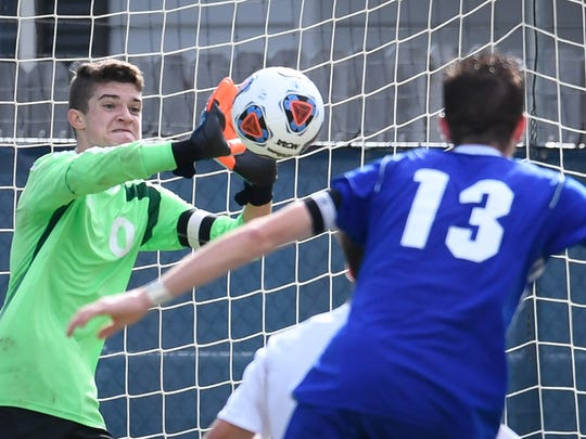 Mater Dei goalie Lucas Daunhauer makes a save in the second period as Memorial plays Mater Dei in the Class 2A Sectional boys soccer final played at Memorial's Traylor Family Stadium Saturday, October 7, 2017.