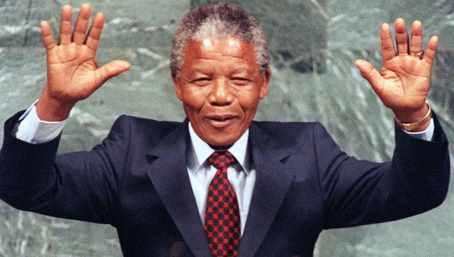 Nelson Mandela, then an African National Congress member, receives applause after a 1990 speech at the United Nations.