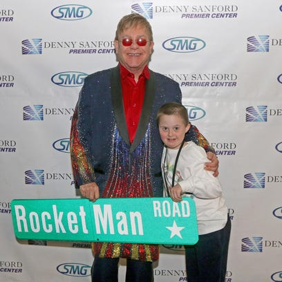 British pop star Sir Elton John greets 10-year-old