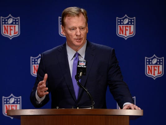 FILE - In this May 23, 2017, file photo, NFL commissioner Roger Goodell speaks to the media after an NFL owners meeting, in Chicago. The NFL is asking a federal court to toss a request from Ezekiel Elliott's legal team for a temporary restraining order that would prevent the league from enforcing a suspension of the Dallas running back over a domestic violence case. The filing Monday night, Sept. 4, 2017, said the request on Elliott's behalf was invalid because it was asking the court to stop a ruling from Harold Henderson before the arbitrator had even made a decision on an appeal of the six-game suspension for last year's NFL rushing leader.(AP Photo/Paul Beaty, File)