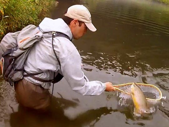 Dan struggles to net a large trout.