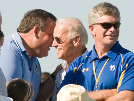 New Jersey Gov. Chris Christie (left) leans in to talk to Vice President Joe Biden as former University of Delaware President Patrick Harker stands nearby at Delaware Stadium in 2010.