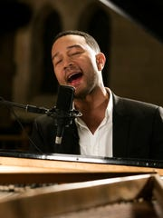 """This Oct. 28, 2015 photo provided by A+E Networks shows John Legend performing as part of the """"Shining A Light: A Concert for Progress on Race in America,"""" in Ferguson, Mo."""