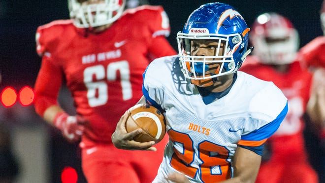 Millville running back Clayton Scott (28) rushes against Rancocas Valley in the NJSIAA Group V South Jersey semis at Rancocas Valley High School in Mt. Holly on Friday, November 18.