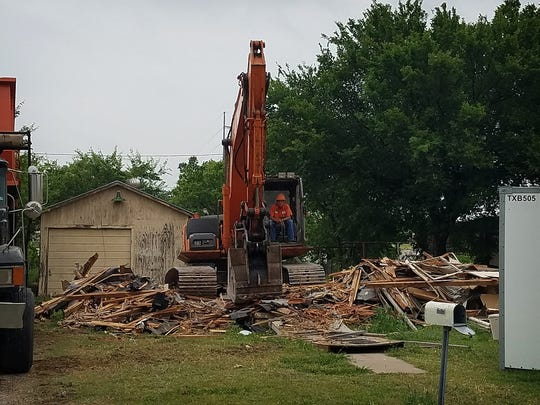 A crew from Wilson Construction demolishes a home on