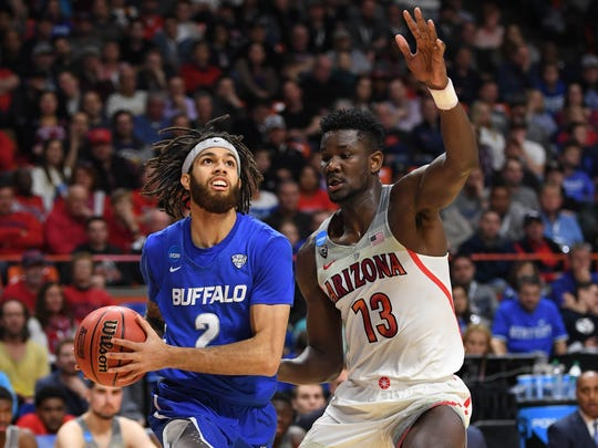Buffalo Bulls guard Jeremy Harris (2) goes up for a shot as Arizona Wildcats forward Deandre Ayton (13) defends in the first half during the first round of the 2018 NCAA Tournament at Taco Bell Arena in Boise, Idaho, on March 15, 2018.