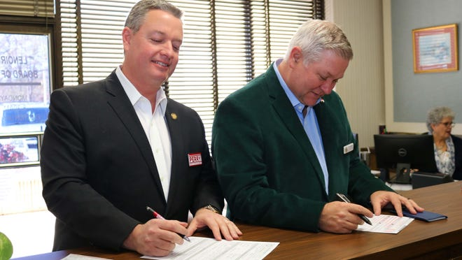 Sen. Jim Perry, left, and Rep. Chris Humphrey met last December at the Lenoir County Board of Elections to file paperwork for this November's general election.