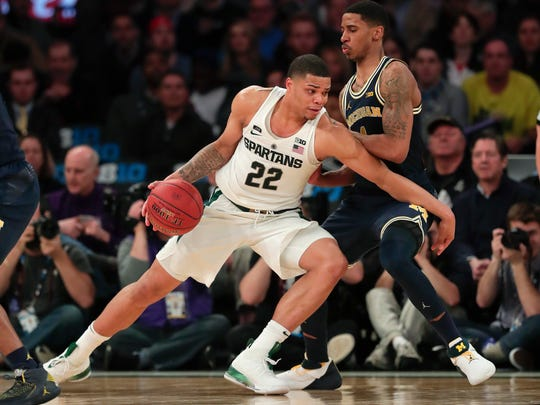 Michigan State guard Miles Bridges (22) drives against Michigan guard Charles Matthews (1) during the second half of an NCAA Big Ten Conference tournament semifinal college basketball game, Saturday, March 3, 2018, in New York. Michigan won 75-64. (AP Photo/Julie Jacobson)