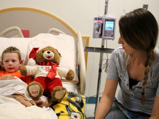 Patient Cooper Hubbs, 5, and his mother Stacia Hubbs are pictured Wednesday after Cooper received a new teddy bear at the San Juan Regional Medical Center in Farmington.