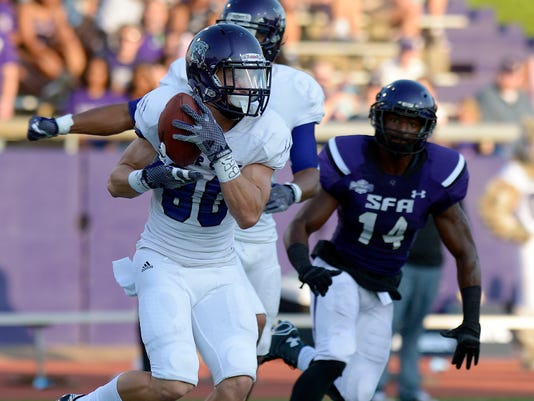 Weber State freshman wide reciver Drew Batchelor pulls in a pass during the first quarter of an NCAA college football game Saturday, Sept. 20, 2014, against Stephen F. Austin State in Nacogdoches, Texas. (AP Photo/The Daily Sentinel, Andrew D. Brosig)