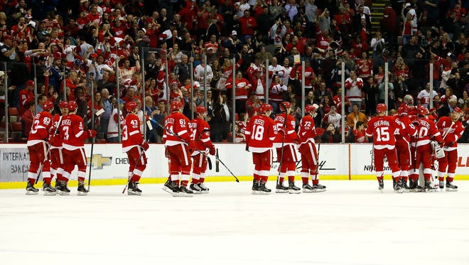 The Red Wings celebrate a 4-3 shoot-out win over the Senators at Joe Louis Arena on April 3, 2017.