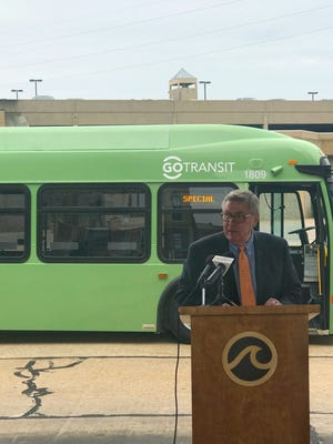 Mayor Steve Cummings stands in front of one of the new buses recently purchased by GO Transit. Seven clean diesel buses will replace 2003 models that officials say have outlived their useful lives.