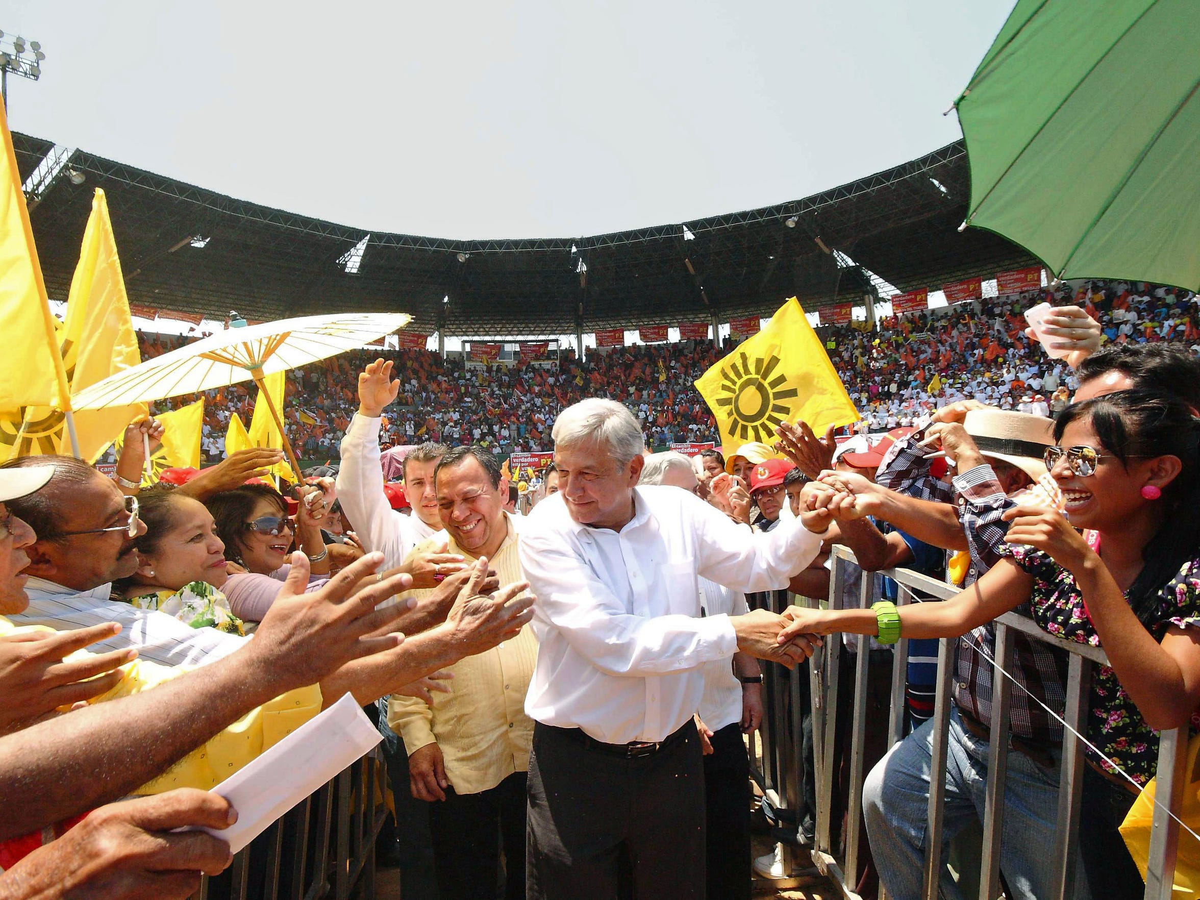Mexican presidential candidate of the leftist coalition Progressive Movement of Mexico Andres Manuel Lopez Obrador  greets supporters during a first massive event on the launch of his campaign for president, in Macuspana, Tabasco State, Mexico, March 30, 2012.