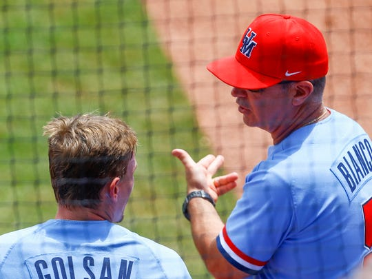 Ole Miss coach Mike Bianco talks with Will Golsan about a base running error during the second inning of a Southeastern Conference tournament NCAA college baseball game against Texas A&M, Saturday, May 26, 2018, in Hoover, Ala. (AP Photo/Butch Dill)