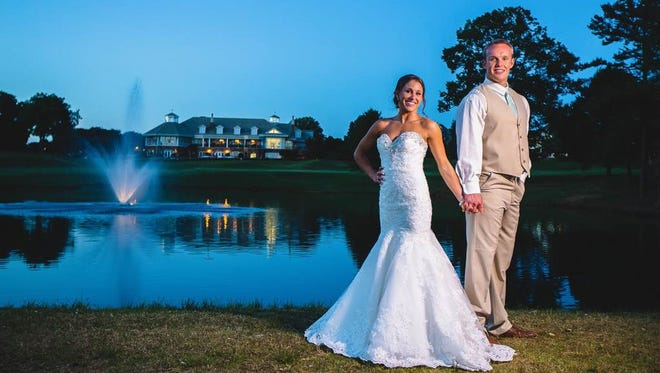 Louisville punter Josh Appleby and his wife, Leslie, a former U of L cheerleader, at their wedding at Lake Norman in Cornelius, N.C., in May.