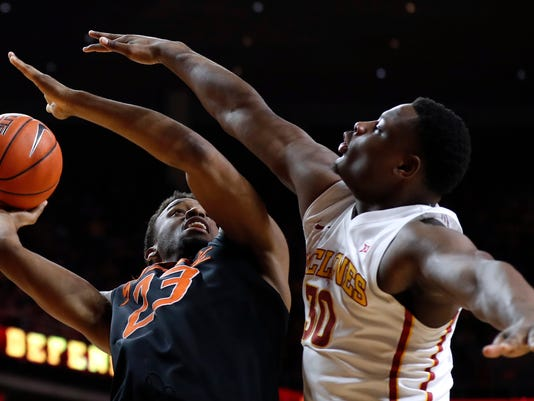 Oklahoma State forward Leyton Hammonds shoots over Iowa State guard Deonte Burton, right, during the second half of an NCAA college basketball game, Tuesday, Feb. 28, 2017, in Ames, Iowa. (AP Photo/Charlie Neibergall)