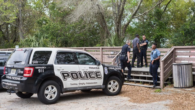 The Pensacola Police Department is on scene at Bay Bluffs Park, where a dead body was discovered Tuesday, March 27, 2018.