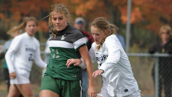 Kinnelon's Ida DiClemente clears the ball up the sideline while being defended by Roxbury's Jamie Irwin during one of the semifinal games of the Morris County Tournament.