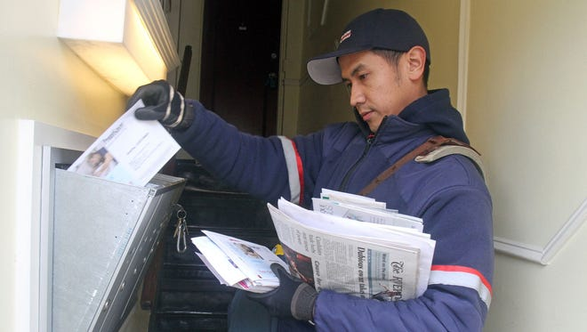 A USPS mail carrier in Irvington, N.Y.