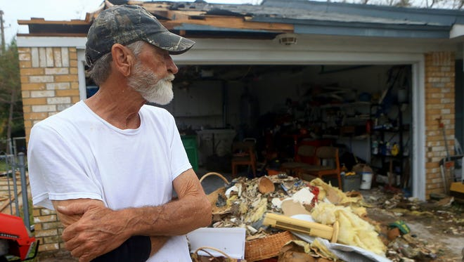 Philip Stevens surveys his home Sunday, Aug. 27, 2017, after part of his house was destroyed by Hurricane Harvey in Aransas Pass, Texas.