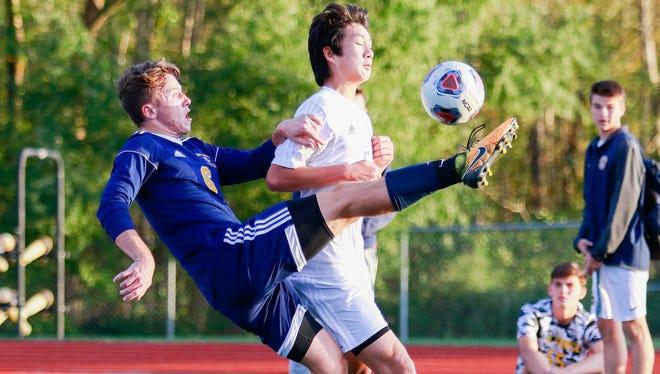 Corey White (6) had a goal and two assists for Hartland in a 4-2 district semifinal soccer victory over Walled Lake Western.