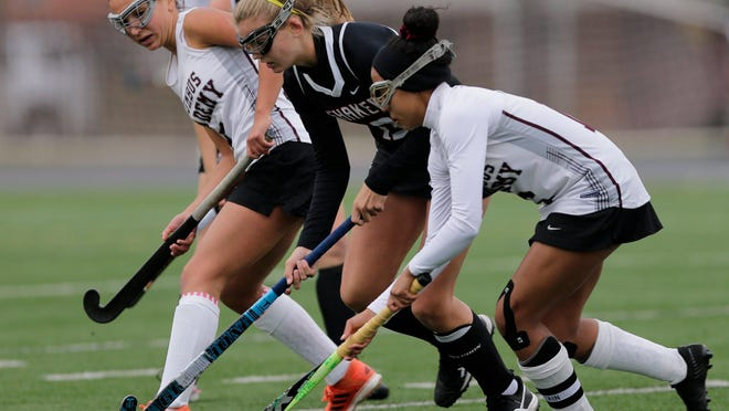 Gurby Vaziri, left, and Kiersten Thomassey compete for Columbus Academy in last year's field hockey state championship game. Field hockey is considered a contact sport by Ohio health officials, but the sport's state coaches association has petitioned Gov. Mike DeWine to change that.