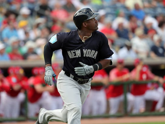 New York Yankees third baseman and top prospect Miguel Andujar watches his second home run of the game against the Philadelphia Phillies during the third inning at Spectrum Field.