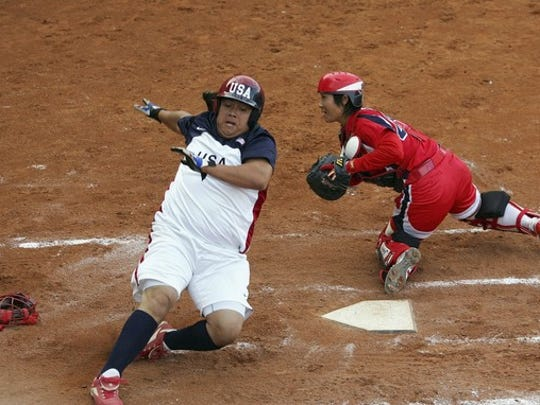 Crystl Bustos scores against Japan at the  ISF XI Women's Fast Pitch Softball World Championship at the Fengtai Softball Stadium in  2006 in Beijing. Bustos will be in El Paso this weekend at the Simply the Best camp.