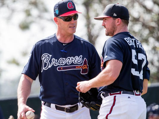 Atlanta Braves bullpen coach Marty Reed talks with pitcher Rex Brothers during a baseball spring training camp in Kissimmee, Fla., Wednesday, Feb. 14, 2018. (AP Photo/Willie J. Allen Jr.)