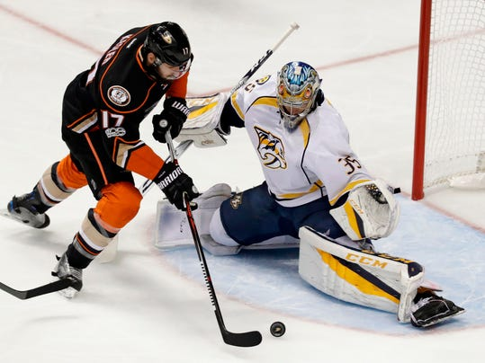 FILE - In this May 20, 2017, file photo, Anaheim Ducks center Ryan Kesler misses a shot against Nashville Predators goalie Pekka Rinne during the first period of Game 5 in the NHL hockey Stanley Cup Western Conference finals in Anaheim, Calif. The Predators and the Ducks developed quite the nontraditional rivalry with intense series the past two playoffs, making that a potentially combustible Western Conference final. (AP Photo/Chris Carlson, File)