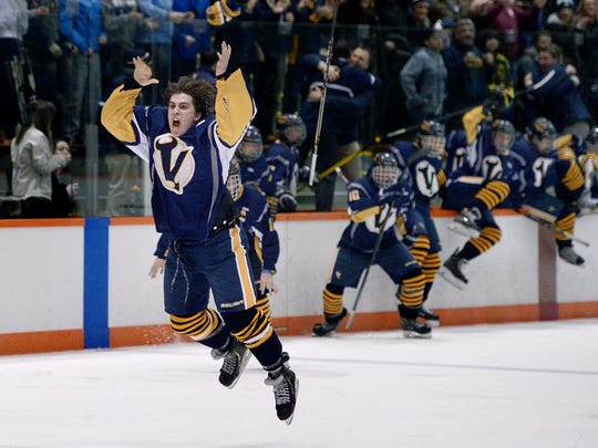 """Victor's David Farrance, left, and the Blue Devils celebrate after winning the Section V Class BB championship in 2015 with a 2-1 win over Greece Thunder. Farrance, who will be drafted by an NHL team June 23-24, said playing high school hockey was an important aspect of his development. """"It was fun to be part of that and I keep in touch with guys on that team.'' ."""