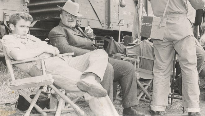 "James Dean, left, and Burl Ives relax between scenes during the filming of ""East of Eden"" in Salinas, Calif., in 1954."
