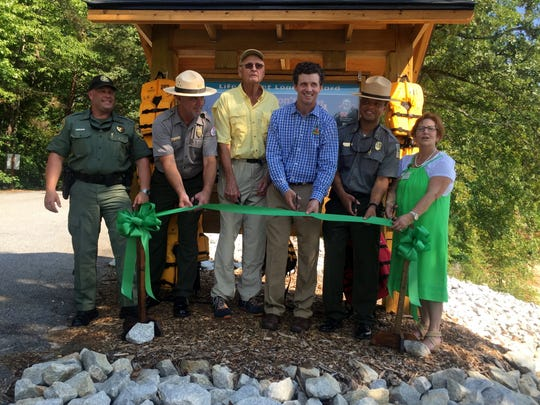 Craig Keese (centered) was flanked by public officials and volunteers who have worked with him to erect life jacket loaning stations at several points around Upstate lakes. Left to right: Sgt. Ron Winegard of the state's Department of Natural Resources, Park Ranger Scott Lusk of the Corps of Engineers, Keese, Dr. Scott Dobson, Lake Hartwell State Park Manager Robert Dinkins and Daby Snipes of Safe Kids Upstate.