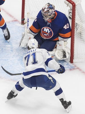 Tampa Bay Lightning center Anthony Cirelli (71) scores on New York Islanders goaltender Semyon Varlamov (40) during overtime in Game 6 of the NHL hockey Eastern Conference final, Thursday, Sept. 17, 2020, in Edmonton, Alberta.