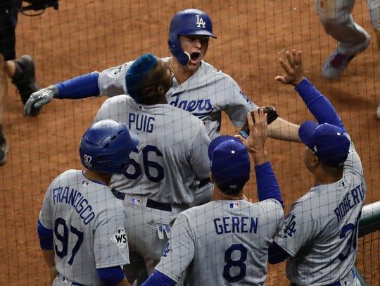 Los Angeles Dodgers' Joc Pederson is congratulated