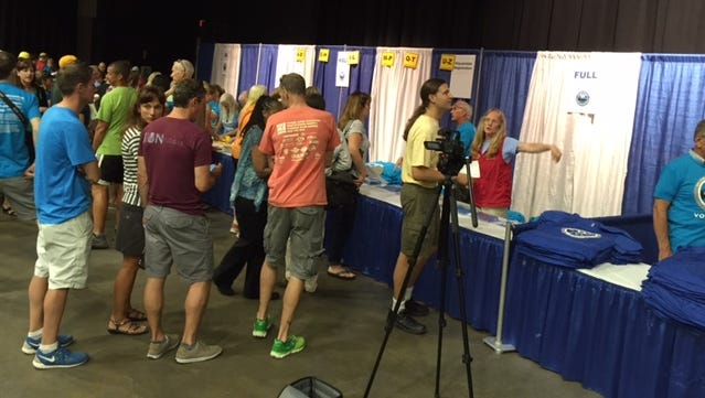 Attendees gather at the Walkway Marathon Health & Wellness Expo Friday.