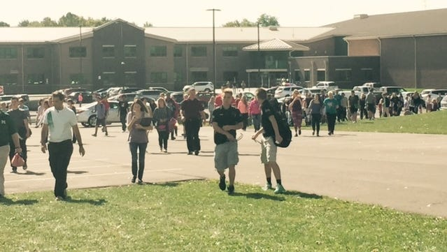 Madison Comprehensive High School students leave school Oct. 7 after being released because of a bomb threat.