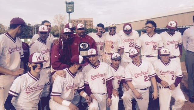 Detroit Western poses with the PSL championship trophy after Monday's win over Renaissance at Wayne State.